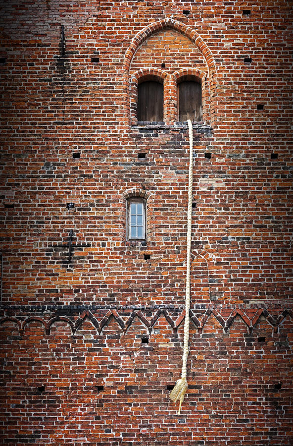 Free Rapunzel Story, A Long Blond Hair Plait Hanging Out Of The Window Of An Old Brick Tower Stock Photography - 55814812