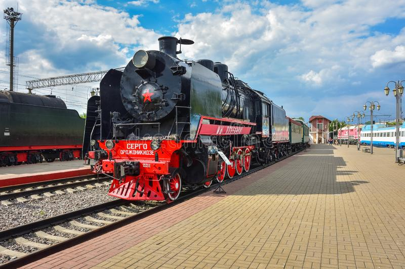 Rare black and red steam train Sergo Ordzhonikidze in the museum of steam locomotives at the Riga station. Moscow  Russia - May 26, 2019: rare black and red stock photography