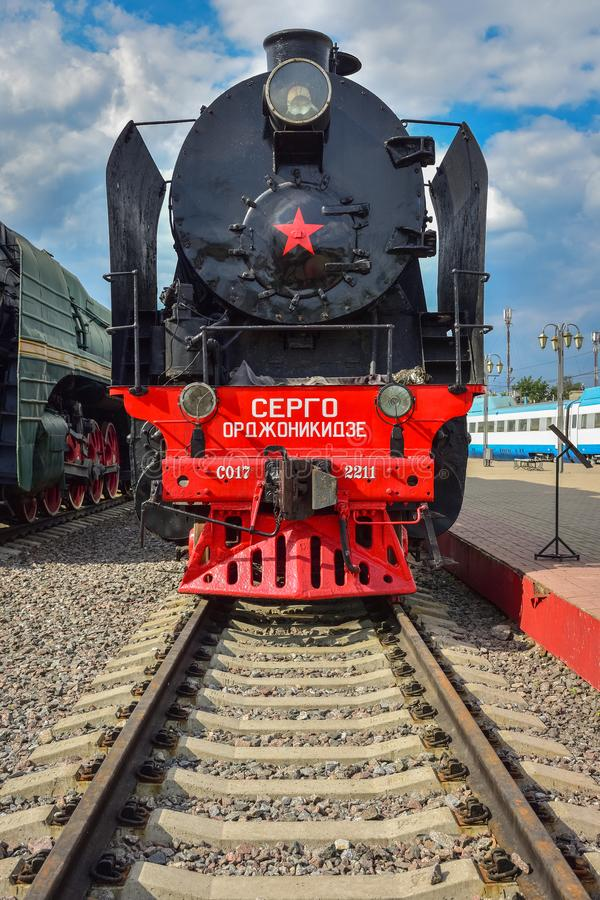Rare black and red steam train Sergo Ordzhonikidze in the museum of steam locomotives at the Riga station. Moscow  Russia - May 26, 2019: rare black and red stock photo