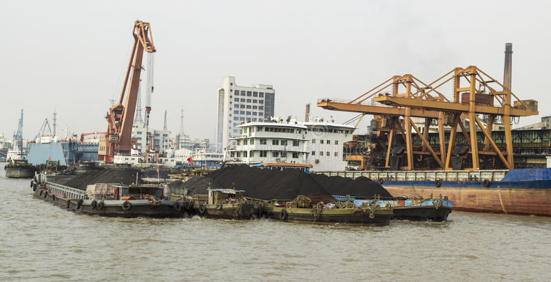 Rare Earth Soil on Ships. Cargo ships loaded with rare earth soil for export in China royalty free stock images