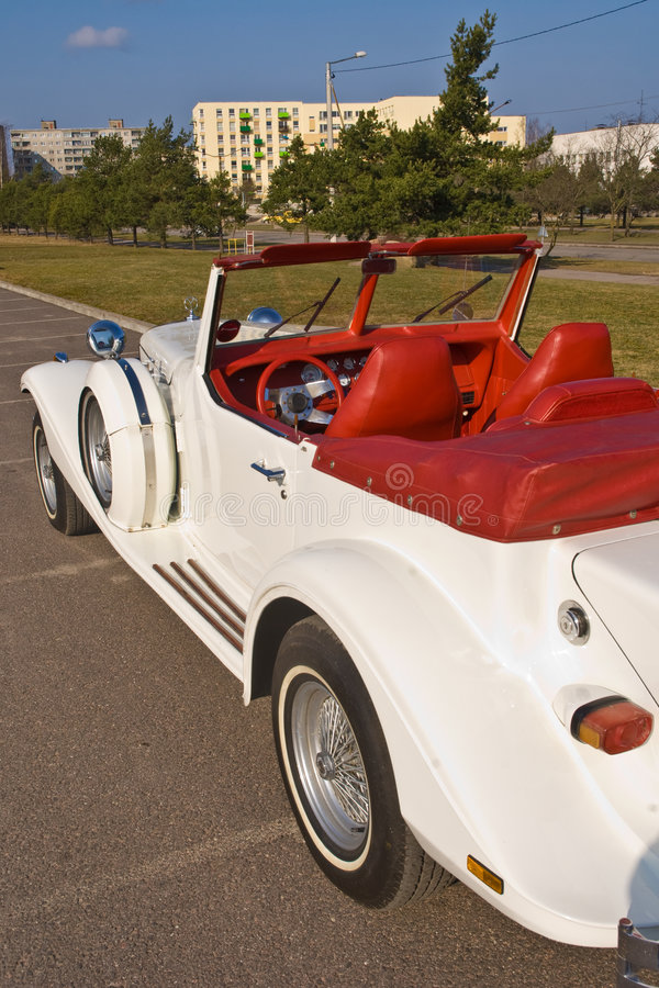 Rare Excalibur cabrio roadster. A view looking into the red leather interior of a beautiful white and exceptionally rare Excalibur cabrio or convertible roadster stock photography