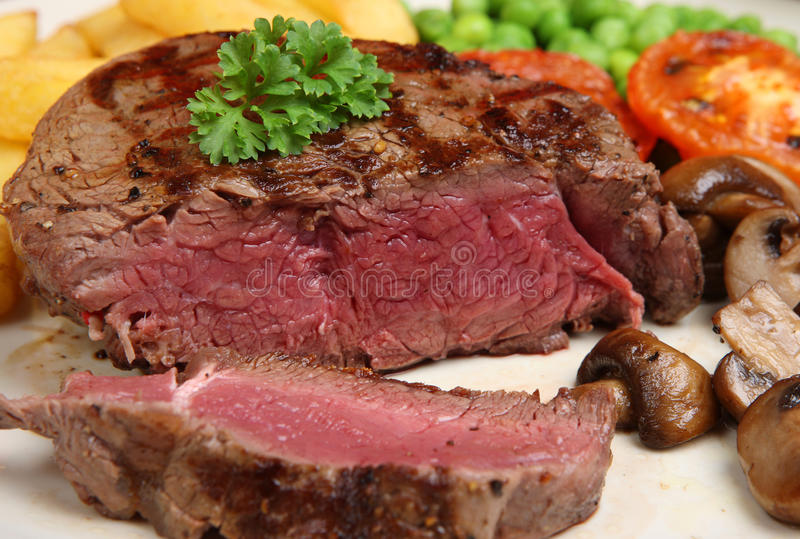 Download Rare Fillet Steak & Chips stock image. Image of parsley - 10765053