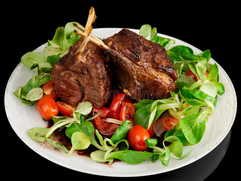 Rare Fried Rack Of Lamb Isolated On Black Royalty Free Stock Photos