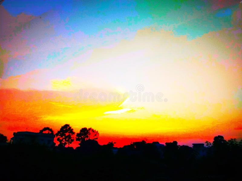 Rare and matchless graphic designing of a sunset. Rare and matchless pattern and graphic designing of a sunset with eye-catching colour combination on black stock image