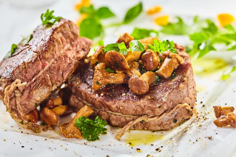 Rare roasted thick juicy beef fillet medallion stock photography