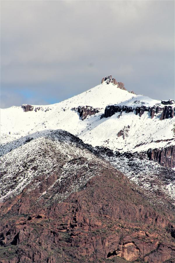 Superstition Mountains Arizona, Tonto National Forest, Apache Junction, Arizona, United States. Rare scenic snow landscape view of the Superstition Mountains in stock image
