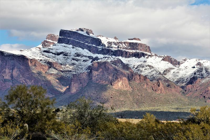 Superstition Mountains Arizona, Tonto National Forest, Apache Junction, Arizona, United States. Rare scenic snow landscape view of the Superstition Mountains in stock photography