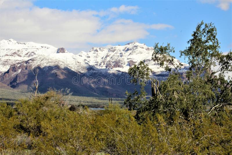 Superstition Mountains Arizona, Tonto National Forest, Apache Junction, Arizona, United States. Rare scenic snow landscape view of the Superstition Mountains in royalty free stock photography