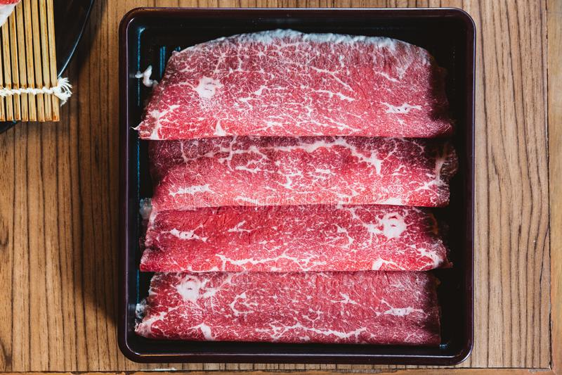 Rare slices authentic A5 Grade Japanese Wagyu beef with high-marbled texture for Shabu stock images