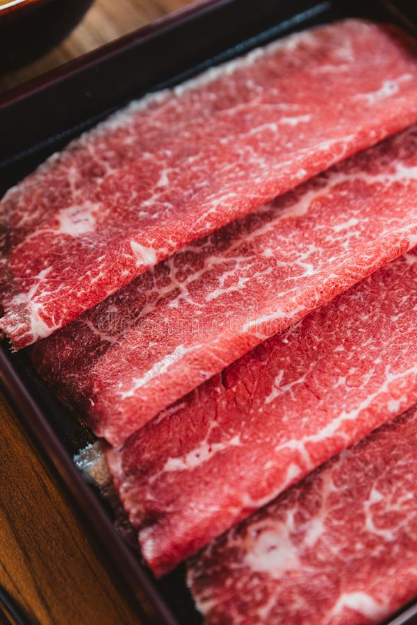 Rare slices authentic A5 Grade Japanese Wagyu beef with high-marbled texture for Shabu royalty free stock image