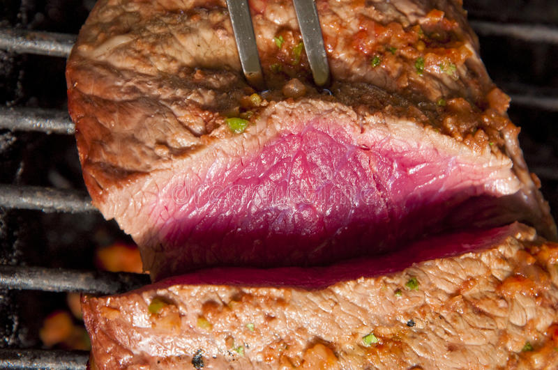 Rare Steak On The Grill stock photo