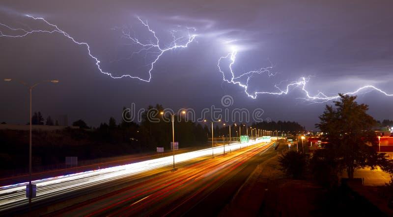 Rare Thunderstorm Producing Lightning Over Tacoma Washington I-5 South. Lightning Bolts light up the sky late at night in Tacoma Washington royalty free stock photo