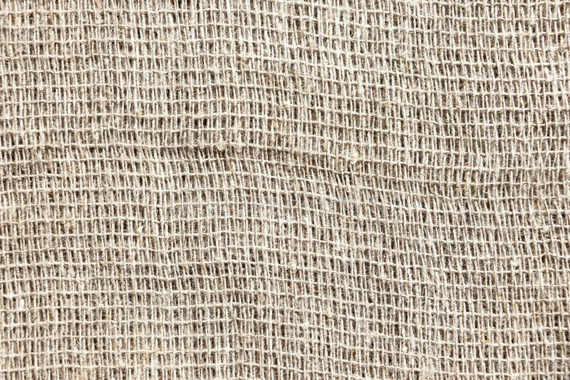 Rarely woven gray coarse fabric. Sackcloth. May serve as a good option for the background royalty free stock photos