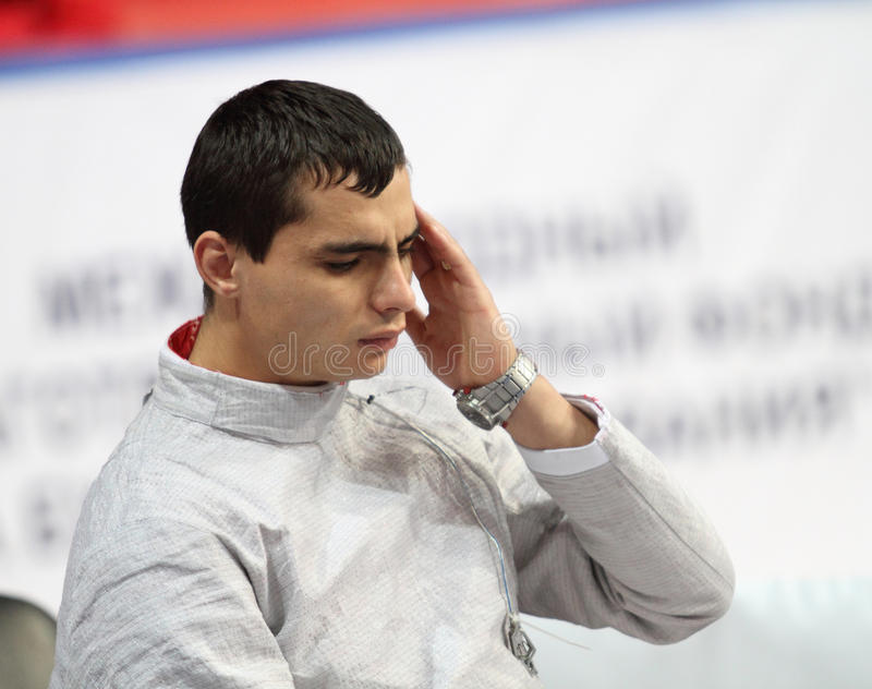 Rares Dumitrescu. (ROU) compete at the 2010 RFF Moscow Saber World Fencing Tournament in Moscow, Russia royalty free stock photo
