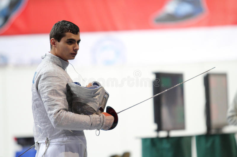 Rares Dumitrescu. (ROU) compete at the 2010 RFF Moscow Saber World Fencing Tournament in Moscow, Russia royalty free stock photography