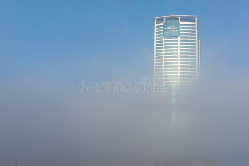 Ras Al Khaimah City in the United Arab Emirates in the early morning fog. Julphur Towers, RAK Properties, peeks above the clouds. `RAK, RAK/UAE - 10/5/2018 Ras royalty free stock photography