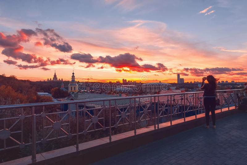 RAS Sightseeing Platform Moscow. Moscow State University MSU, Church. Sun rays and clouds at sunset. royalty free stock photography