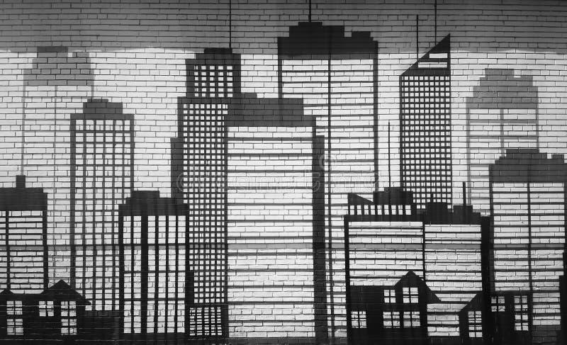 Rascacielos dramáticos en fondo de la pared de ladrillo de la calle imágenes de archivo libres de regalías
