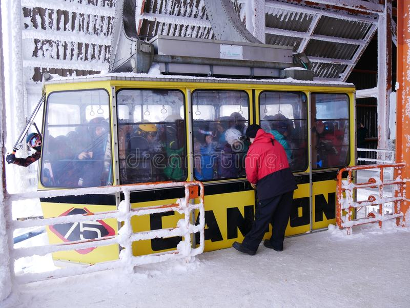 Rascal in crowded ski gondola stock photo