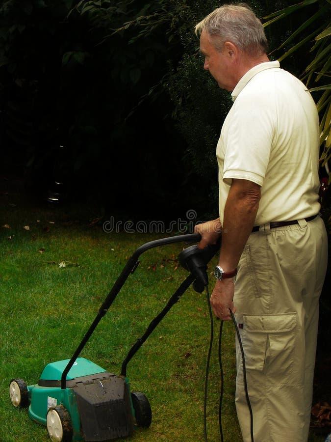 Rasenmähmaschine-Mann lizenzfreies stockbild