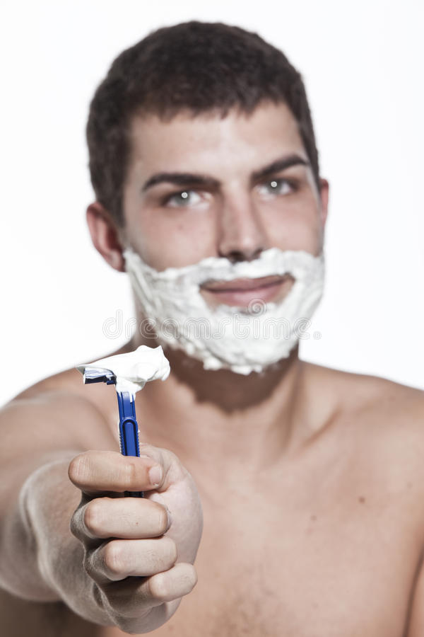 Rasieren des jungen Mannes lizenzfreies stockbild