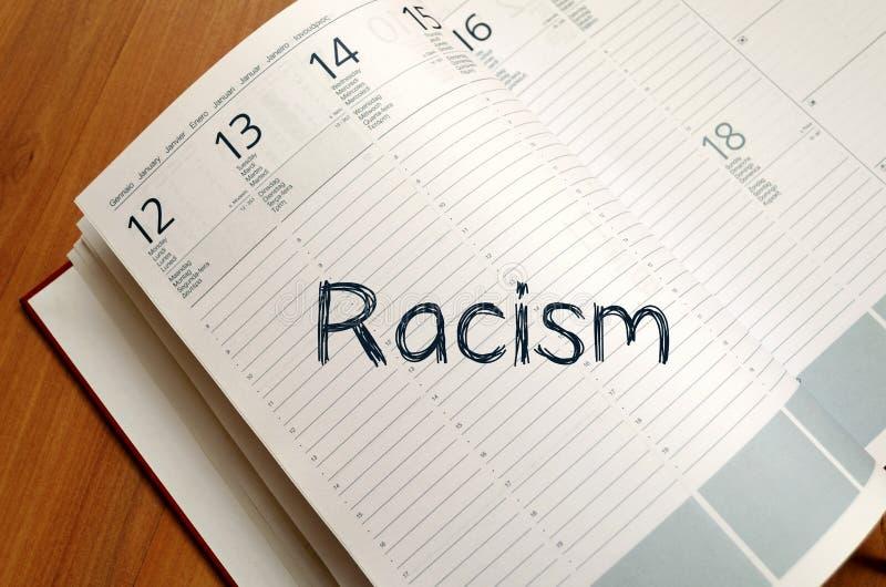 Rasism skriver på anteckningsboken royaltyfria foton
