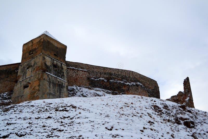 Old Rasnov citadel walls. Rasnov citadel walls up the hill covered with snow, Transylvania, Romania royalty free stock photography