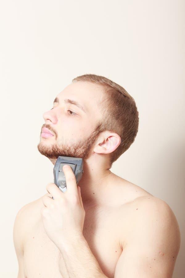 Rasoio elettrico di rasatura barbuta del tipo immagini stock