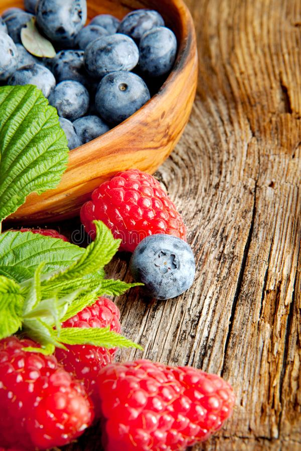 Raspberries and blueberries - close up stock photography