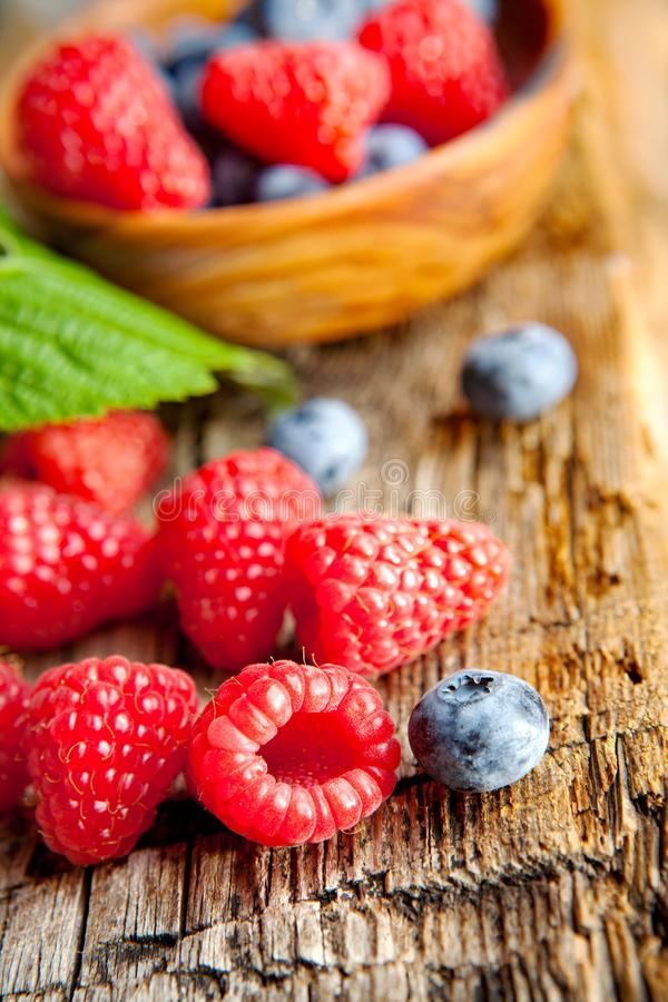 Raspberries and blueberries - close up royalty free stock photos