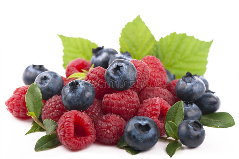 Download Raspberries And Blueberries On White Background Stock Photo - Image: 25752960