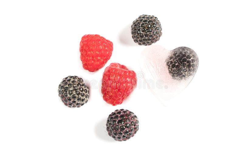 Raspberries and chunks of ice on a white background stock illustration