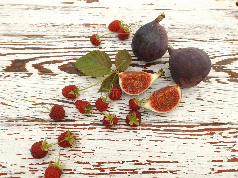 Raspberries and figs royalty free stock photo