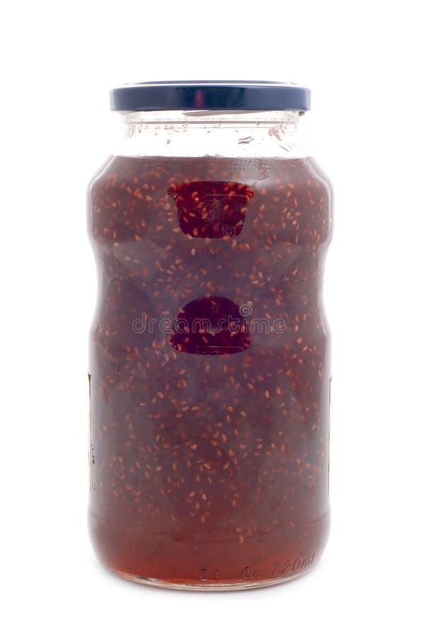Raspberries jam glass jar