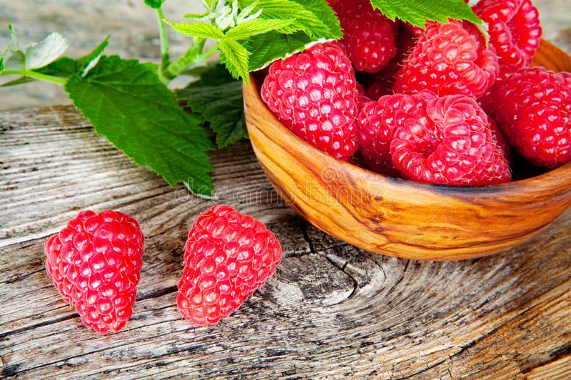 Raspberries in olive bowl - close up stock image