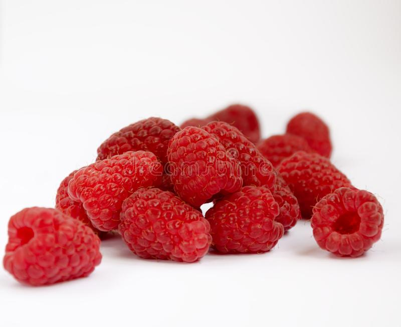 Raspberry berry ripe red. Red raspberry berry, ripe fragrant raspberry berry on a white background, close-up royalty free stock images