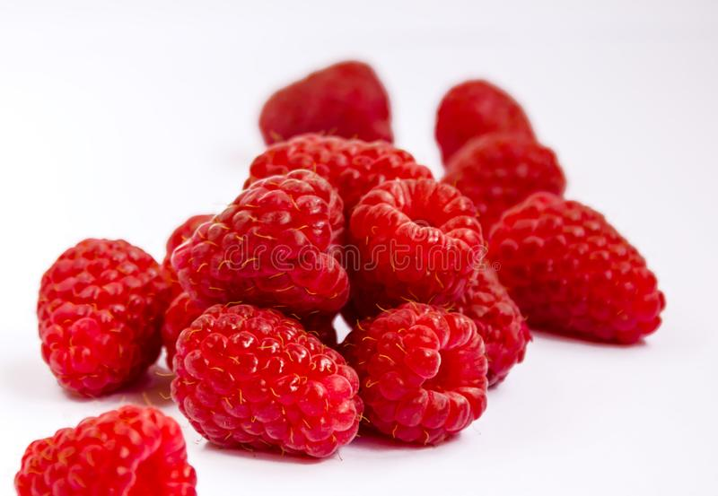 Raspberry berry ripe red. Red raspberry berry, ripe fragrant raspberry berry on a white background, close-up royalty free stock photography