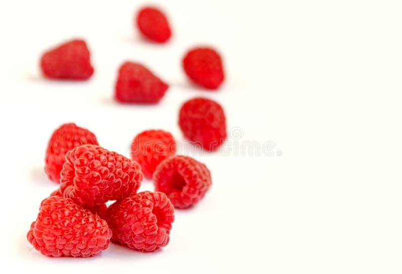 Raspberry berry ripe red. Red raspberry berry, ripe fragrant raspberry berry on a white background, close-up stock image