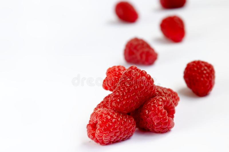 Raspberry berry ripe red. Red raspberry berry, ripe fragrant raspberry berry on a white background, close-up royalty free stock photo