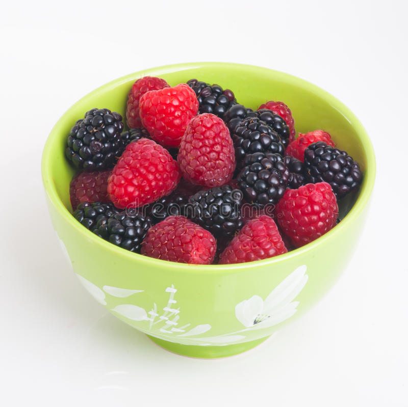 Download Raspberry And Blackberry In Green Bowl On White Stock Photo - Image: 24665280