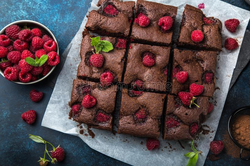 Raspberry brownies on blue background. Top view stock photography