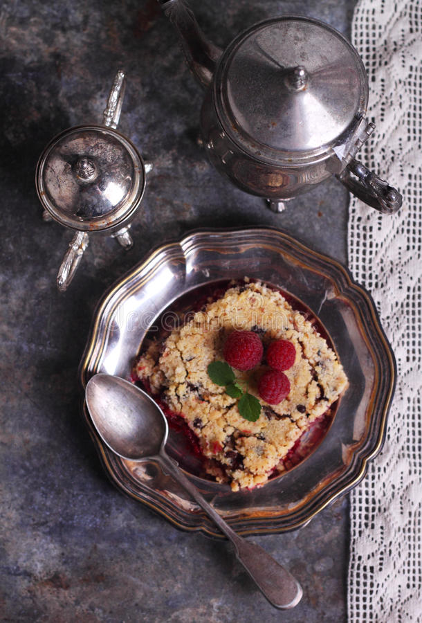 Raspberry crumble. In a metal plate stock photo