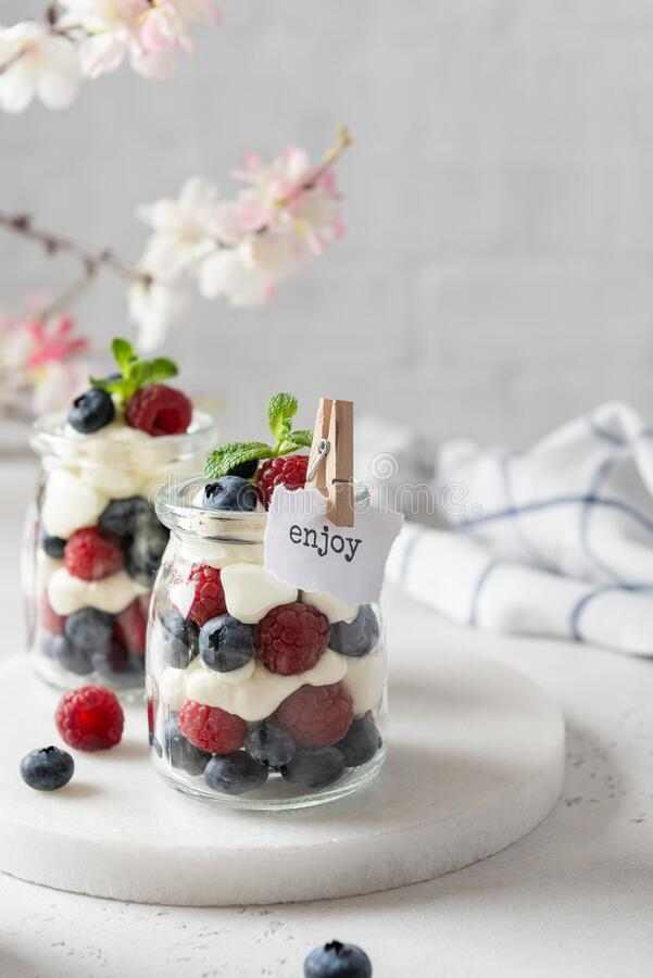 Raspberry dessert, parfait, trifle, mouse in a glass. Confectionery menu. Summer dessert. Copy space. For text stock image