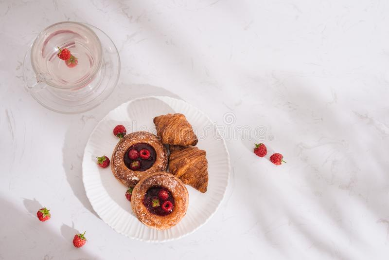 Raspberry filled pastries with sugar sprinkles. Selective focus.  royalty free stock photo