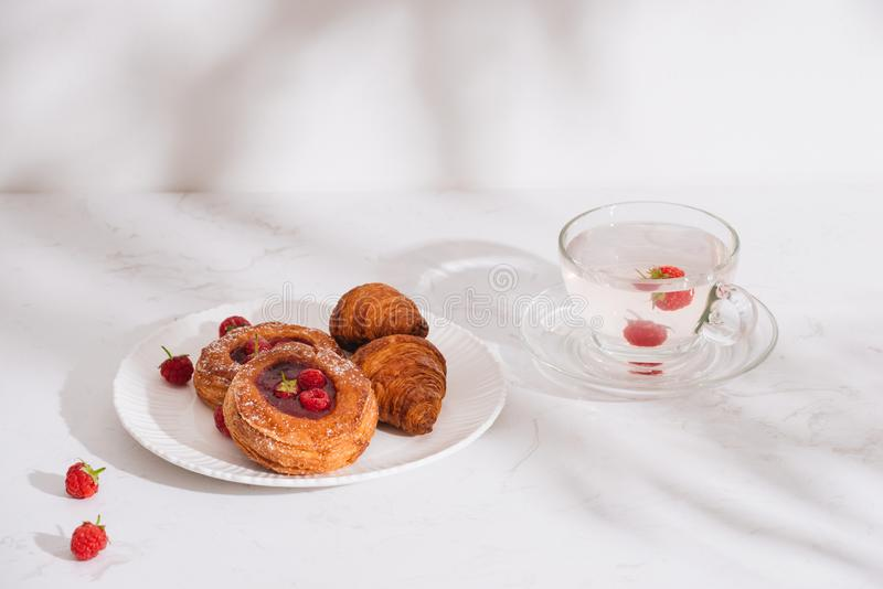 Raspberry filled pastries with sugar sprinkles. Selective focus. Raspberry filled pastries with sugar sprinkles. Selective royalty free stock photo