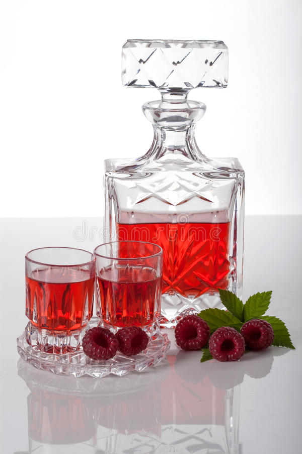 Raspberry homemade liquor. Homemade liquor made with raspberries in carafe stock photography