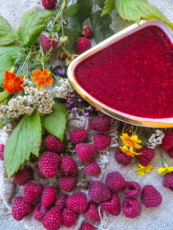 Raspberry jam with fresh raspberry and flowers royalty free stock images