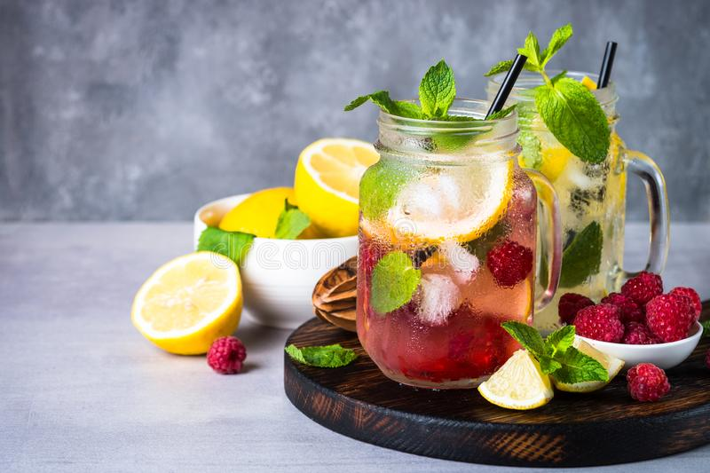 Raspberry lemonade in mason jar. Cold summer iced drink. Close up royalty free stock photos