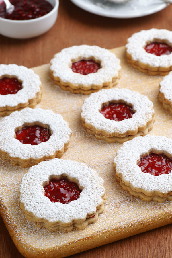 Raspberry Linzer Torte Cookies on Cutting Board royalty free stock photo