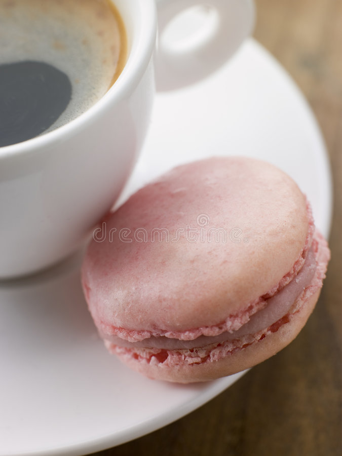 Raspberry Macaroon With A Cup Of Espresso Stock Photography